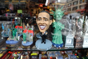 "23 October 2012 - New York - A large-head plastic figurine caricature of President Barack Obama sits on display in the window of a Chinatown shop selling New York City ""chachki"" merchandise on October 23, 2012. No merchandise bearing the likeness of Republican Presidential candidate Mitt Romney was on display or for sale.  Photo Credit: Anthony Behar/Sipa USA (Sipa via AP Images)"